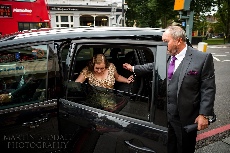 Bride arrives in black cab