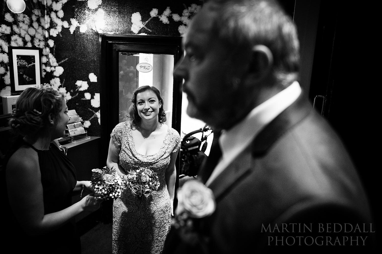 Bride waits in Screen on the Green wedding cinema foyer