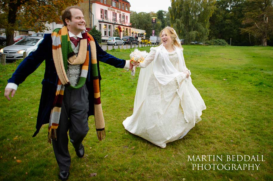 Bride and groom walking near reception venue in Epping Fiorest