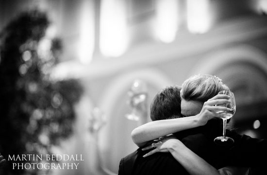 Bride hugs her new husband