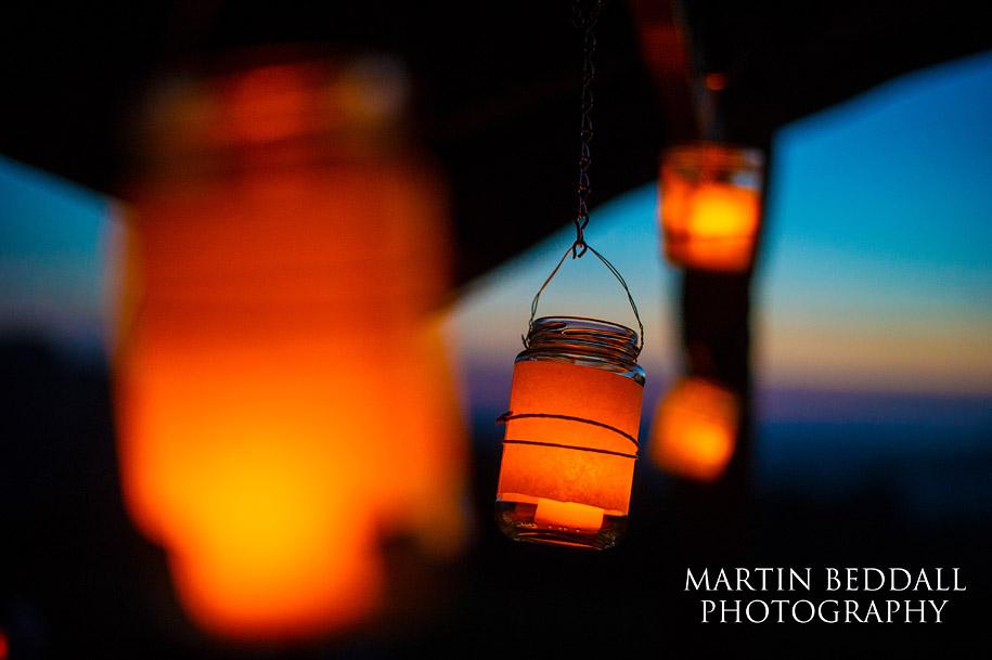 Glowing wedding lanterns at sunset at River Cottage