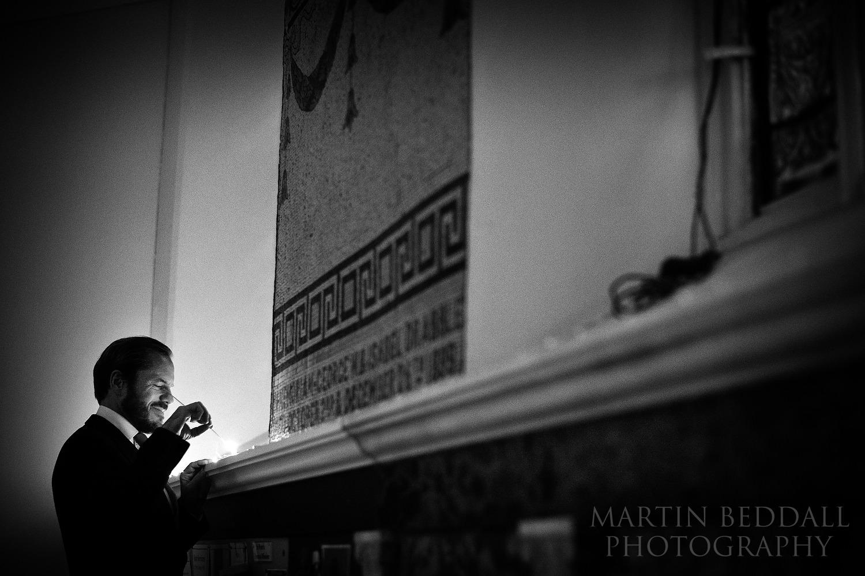 London winter wedding - lighting the candles around the church