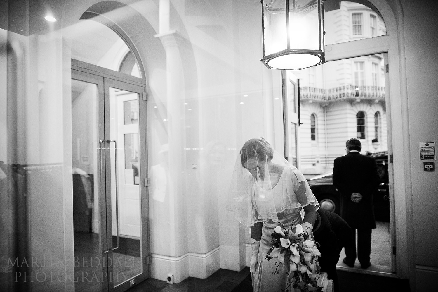 Bride arrives at St Peter's church in Notting Hill