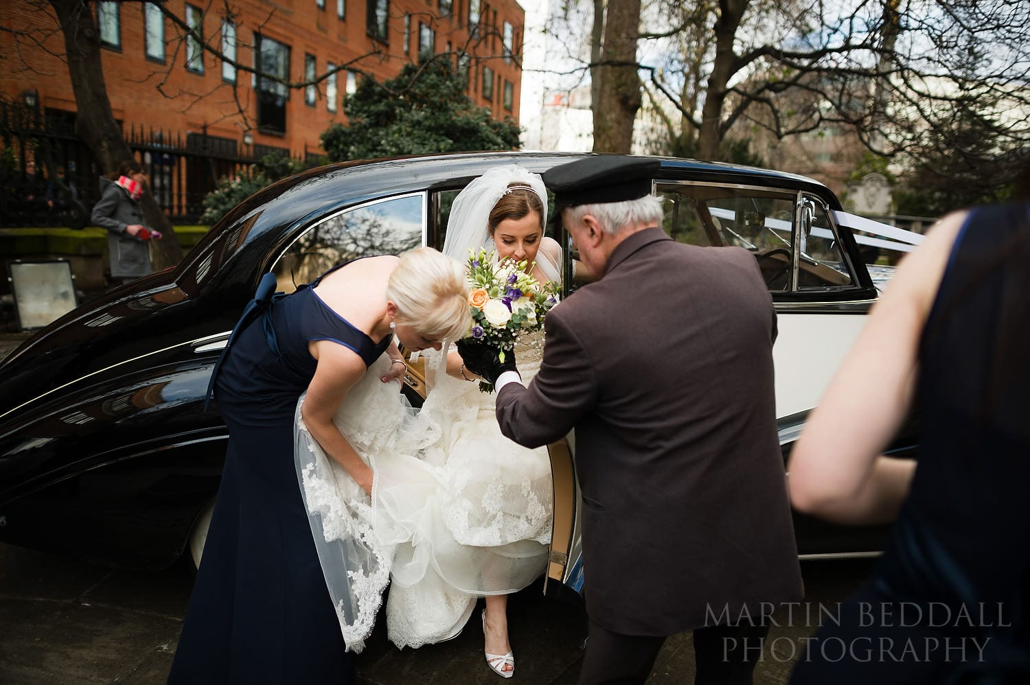 Bride getting out of the wedding car at St Paul's