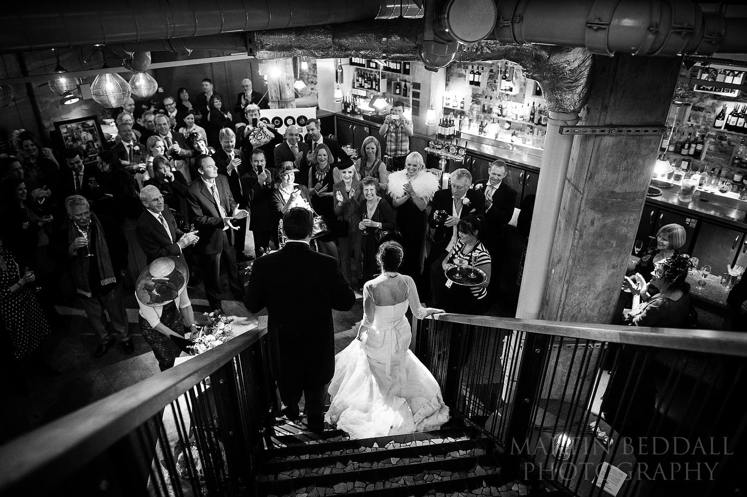Bride and groom arrive for their wedding reception at the Folly Bar