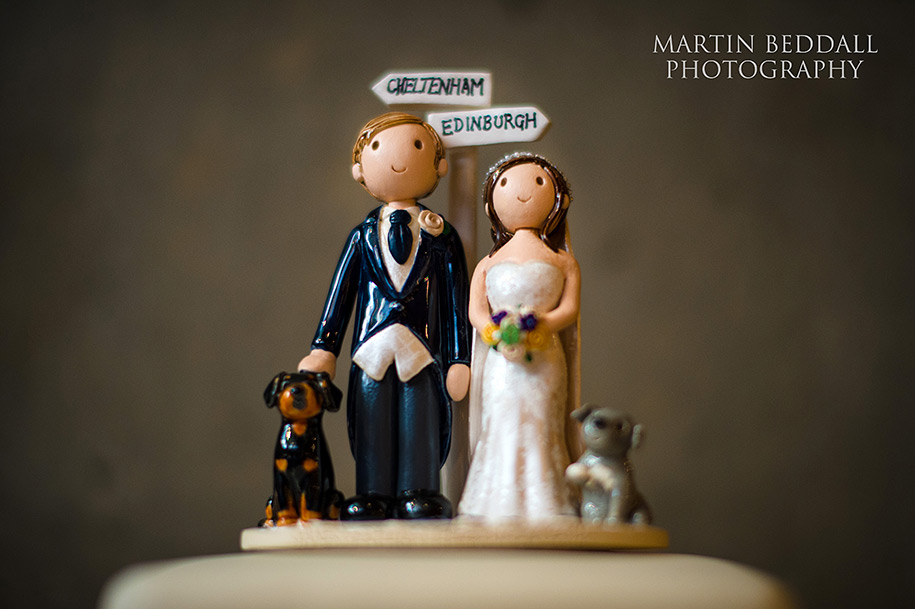 Comical bride and groom figures atop the wedding cake