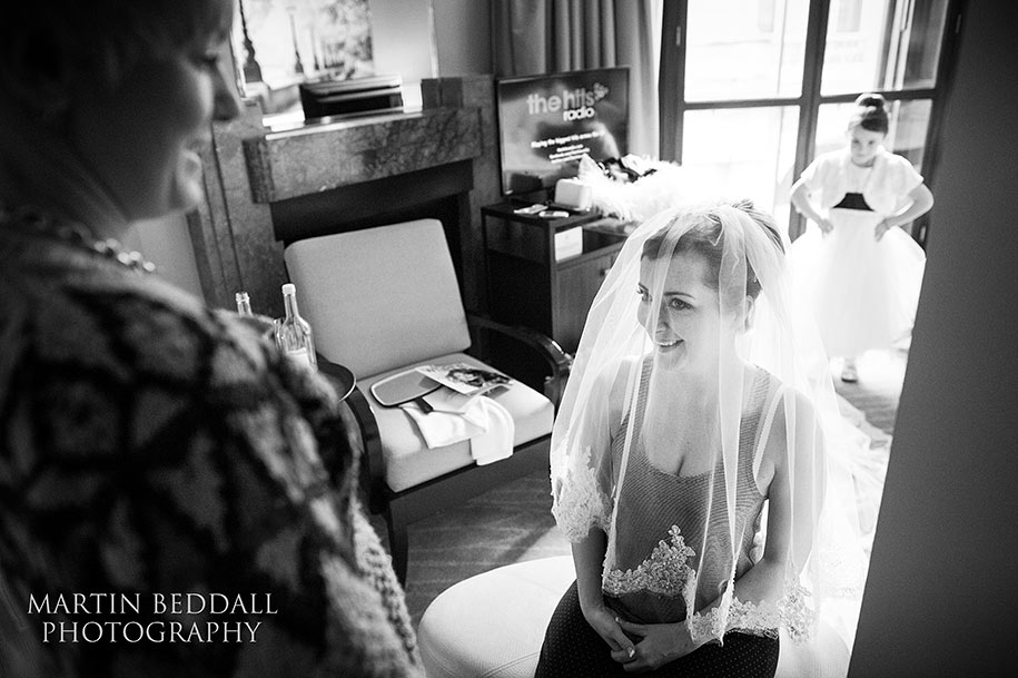 Bride tries on her veil