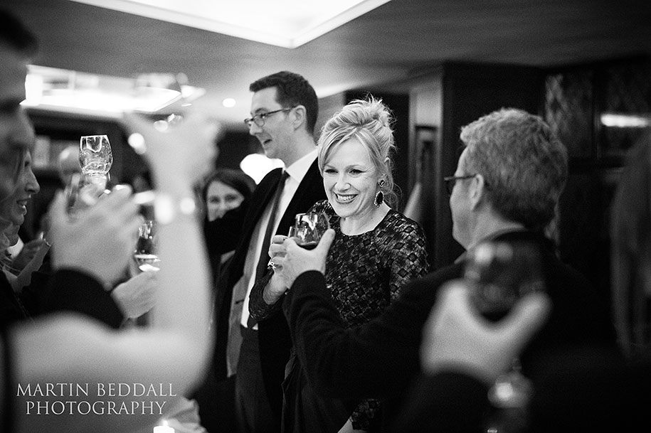 Bride smiles as she toasts guests