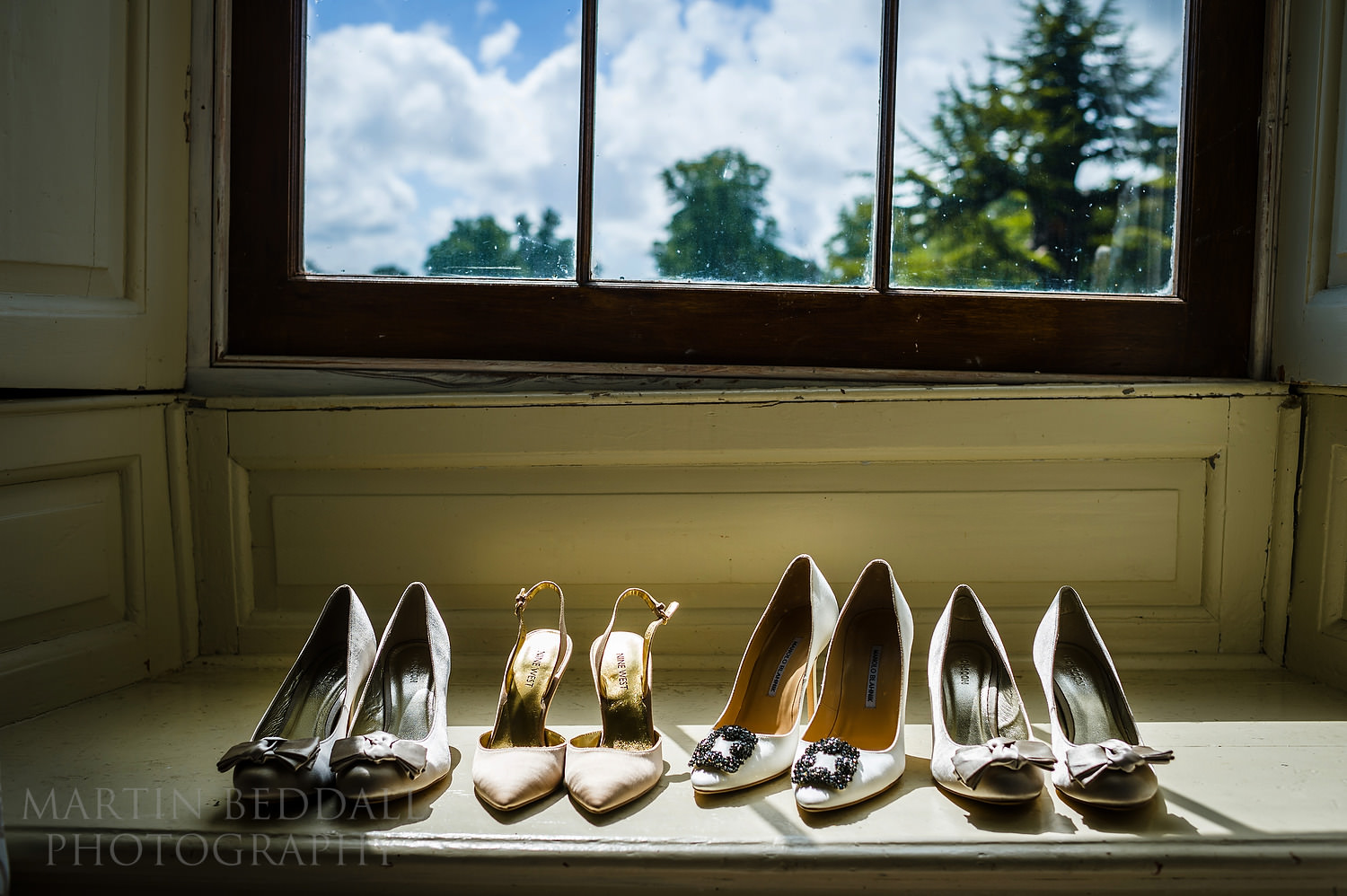 Wedding shoes on the window sill