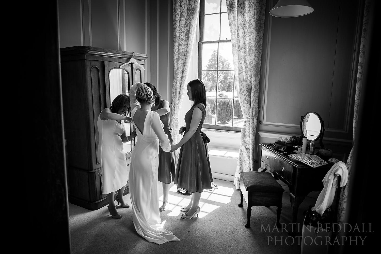 Wedding dress going on at Glemham Hall wedding