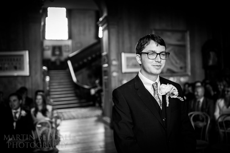 Groom waits at Glemham Hall wedding