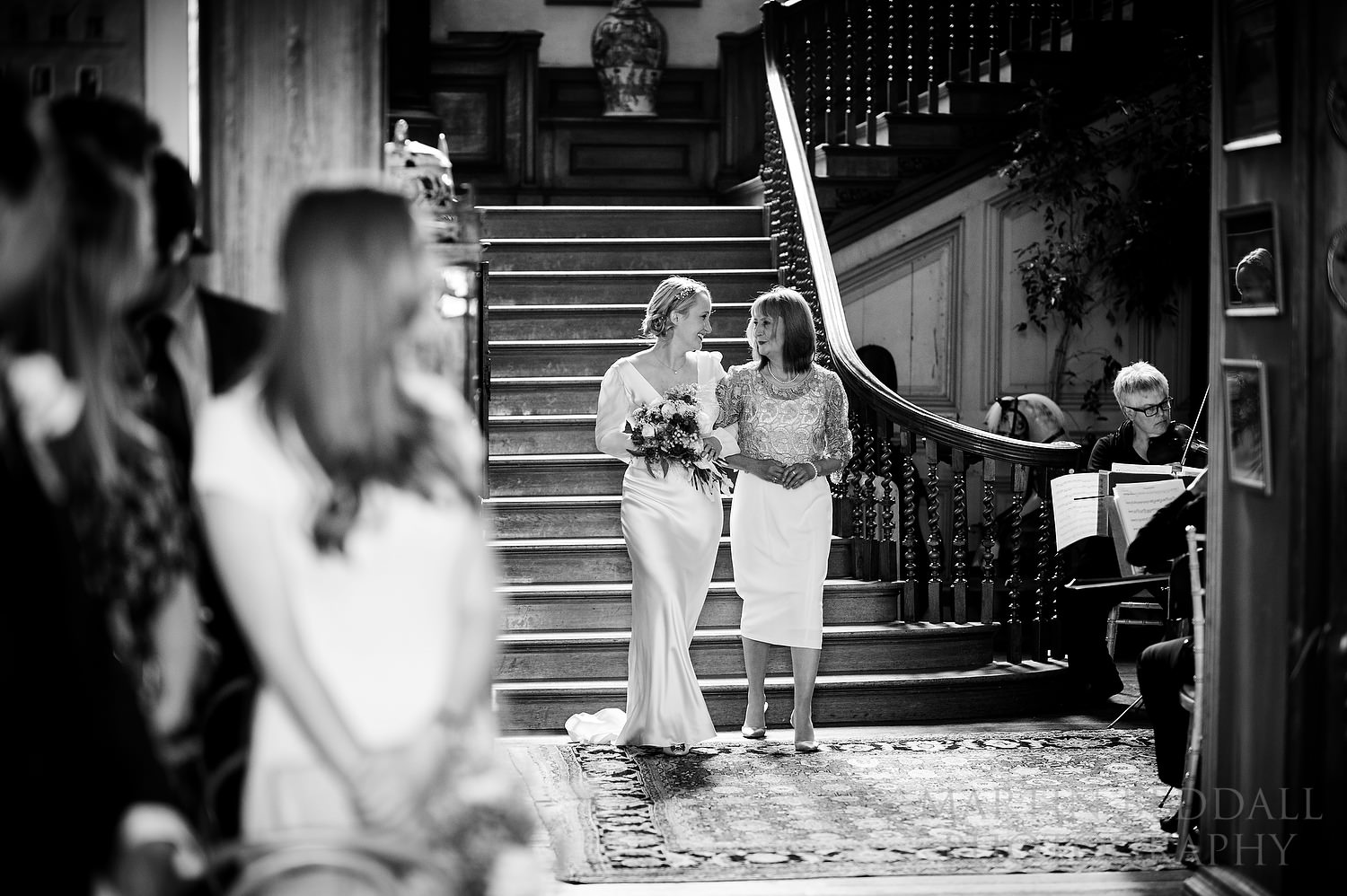 Bride walks to the ceremony with her mother