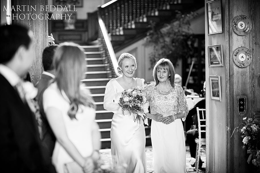 The brdie, Helen, walks into the ceremony room at Glemham Hall