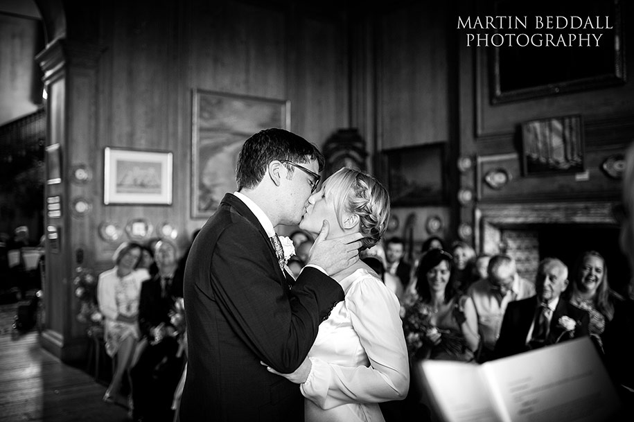 A tender kiss at the end of the marriage ceremony at Glemham Hall