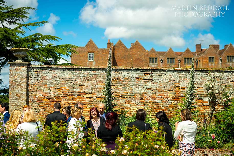 Wedding reception in the rose garden at Glemham Hall