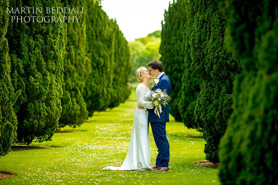 Bride and groom kiss at Glemham Hall