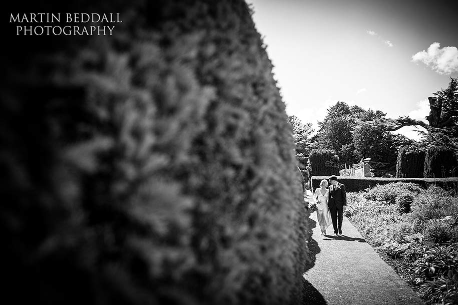 Bride and groom in the grounds of Glemham Hall