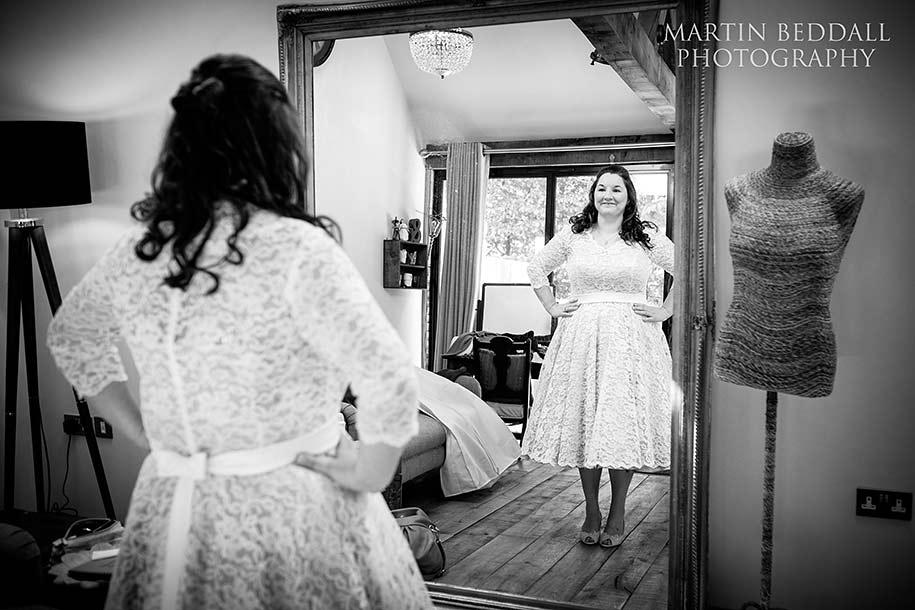 Bride admires herself in the mirror before the ceremony shot on a Fuji X-T1