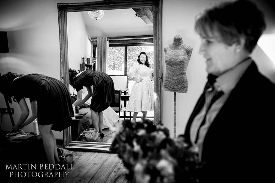 Bride gets ready for her ceremony at the Tythe Barn