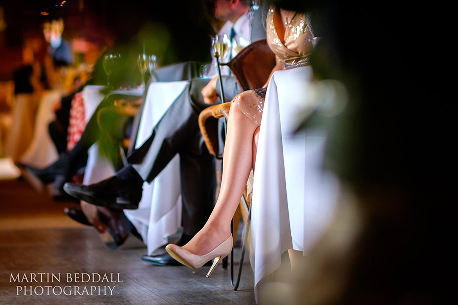 Wedding guest's leg shot on Fuji X-T1 and Zeiss 85mm ZF lens