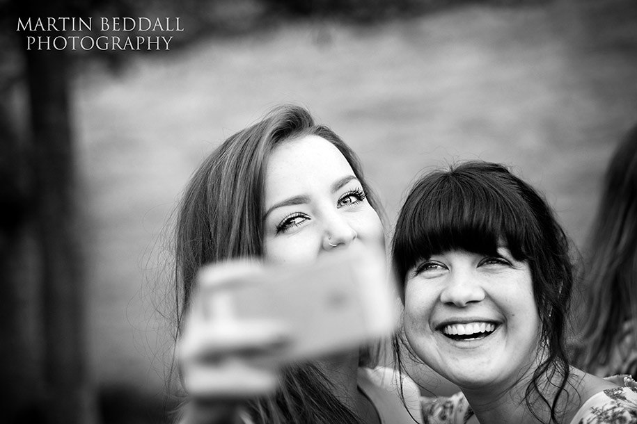 Young wedding guests taking a selfie