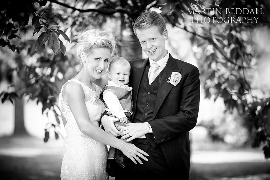 Bride and groom and their young son at Russets wedding venue