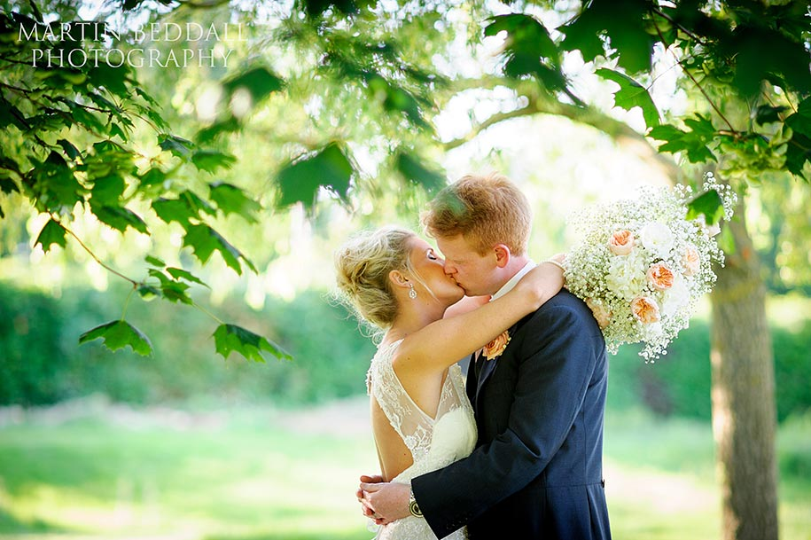 Bride and groom kissing at Russets wedding in Surrey