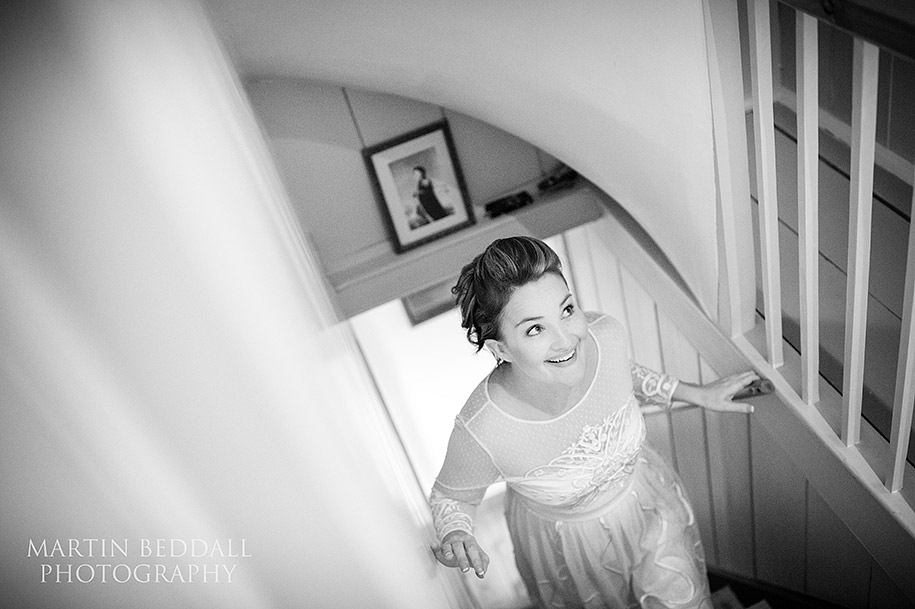 Bride's sister walks up the cottage stairs