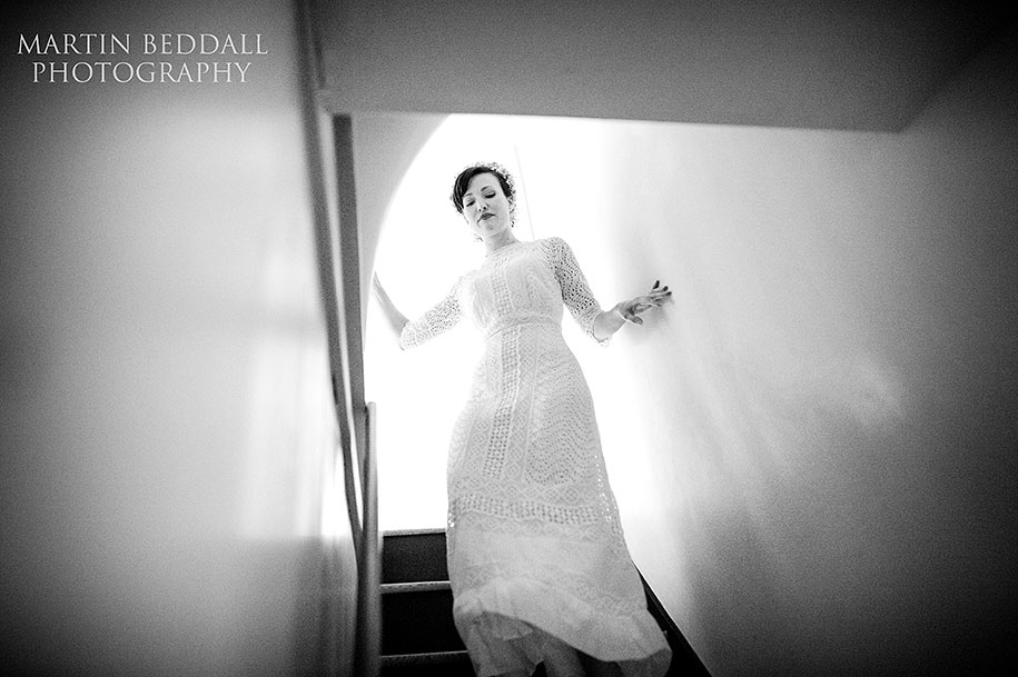 An elegant bride descends the stairs