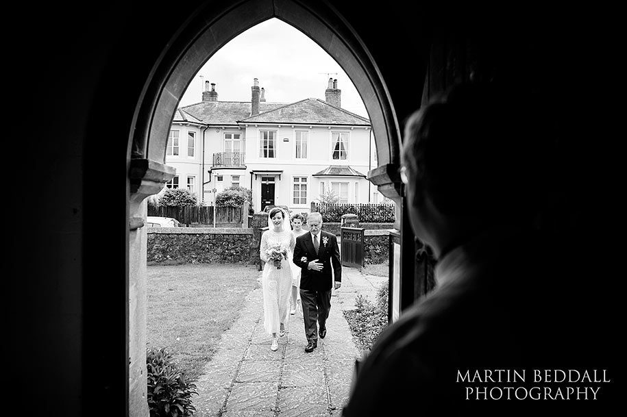 Bride walks with her father to the church