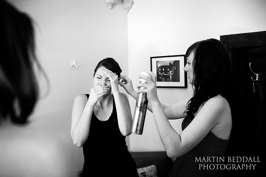 Bride getting ready with hairspray