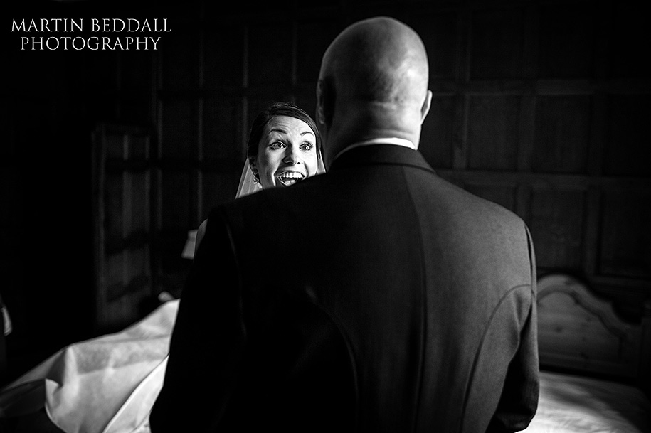 Bride joking with her father before the wedding ceremony