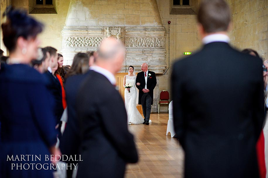 Bride enters Bradenstoke hall at St Donat's with her father
