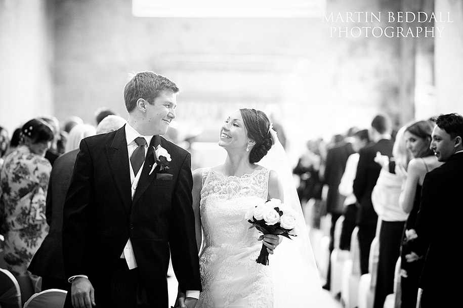 Smiling bride and groom at St Donat's castle