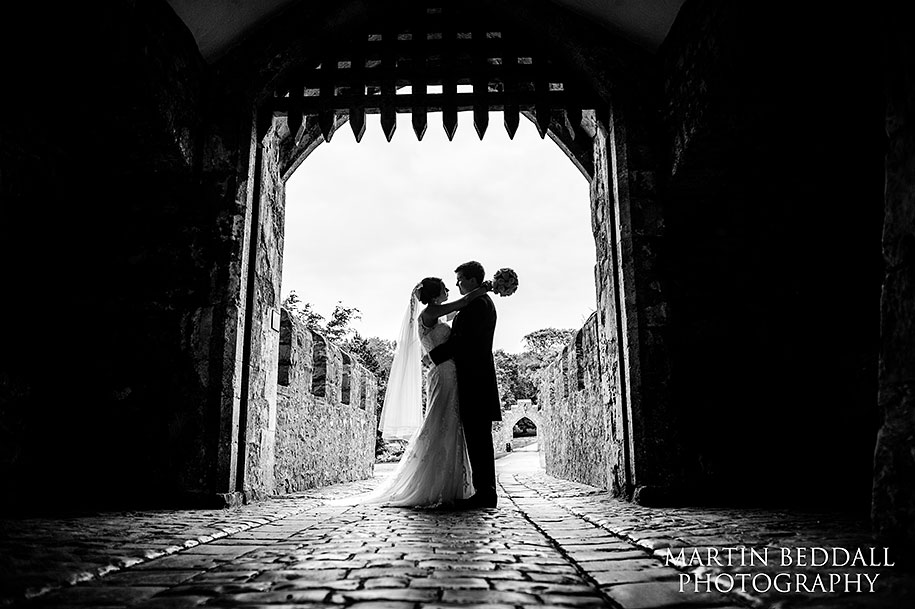 Bride and groom at St Donat's castle in Wales