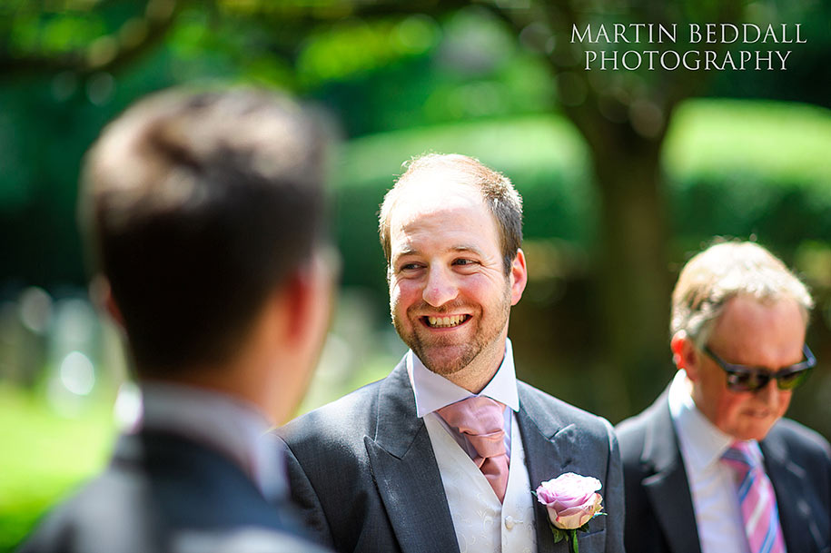 A smiling best man