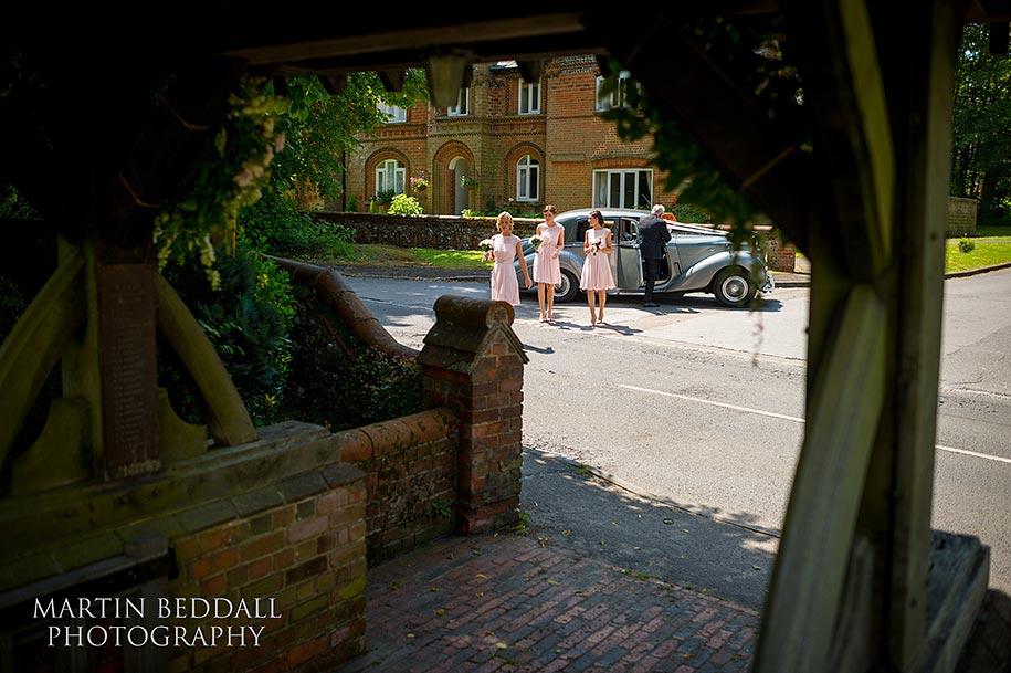 Bridesmaids arrive at the church