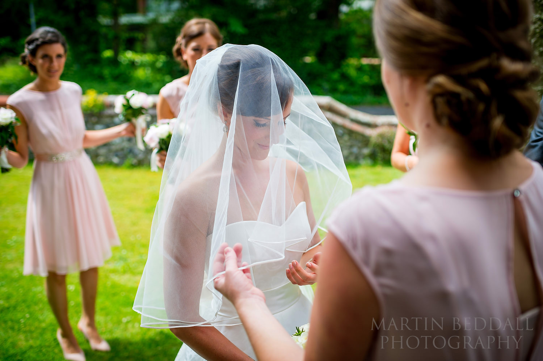 Wedding veil goes on