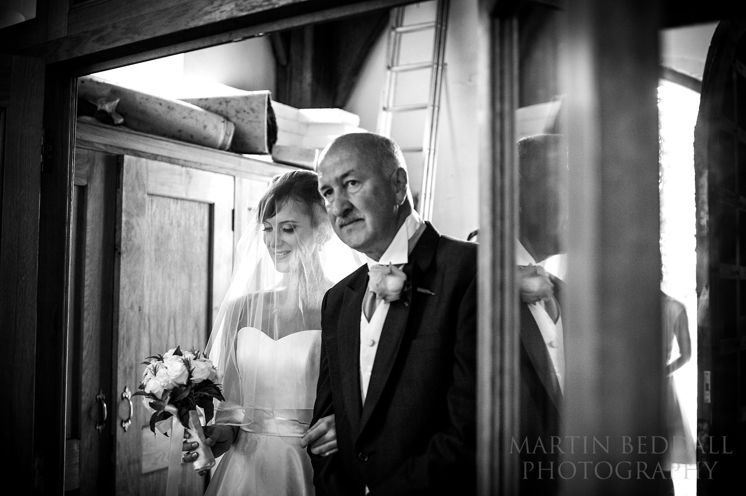 Bride and her father enter the church