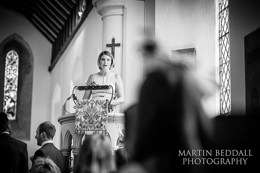 A reading in the pulpit by the groom's sister