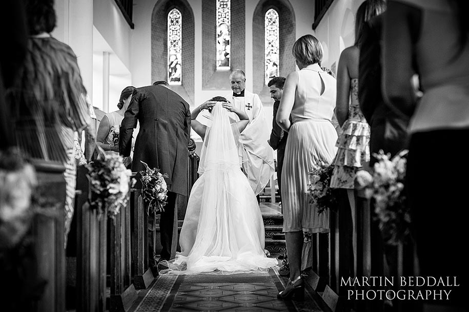Bride's father steps on her veil