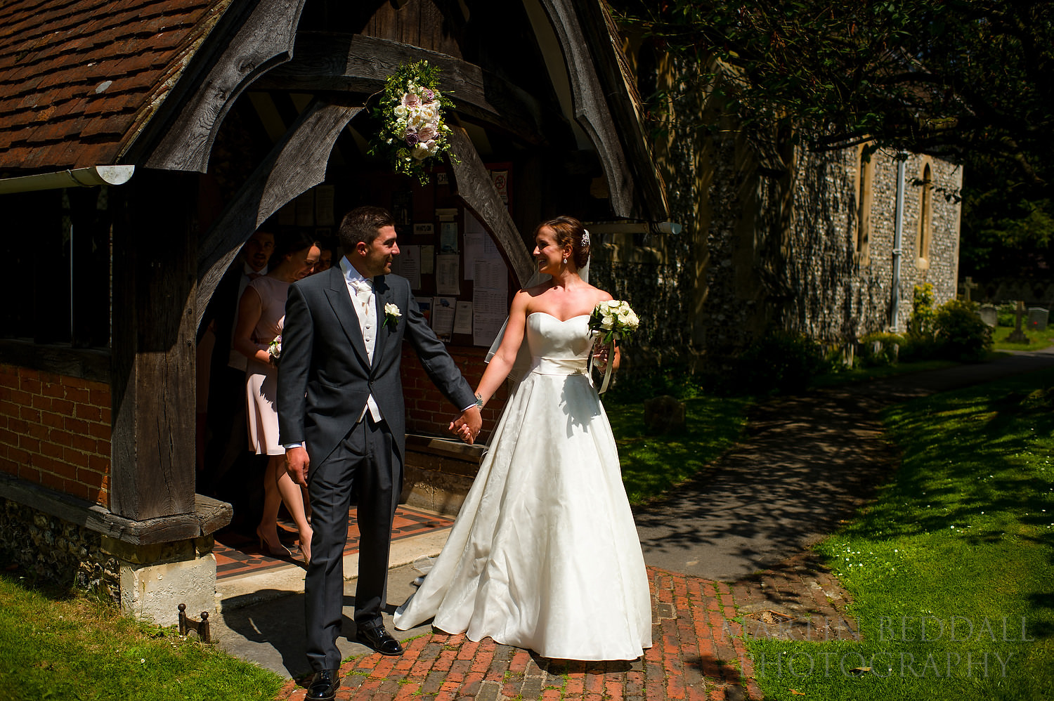 Bride and groom outside the church