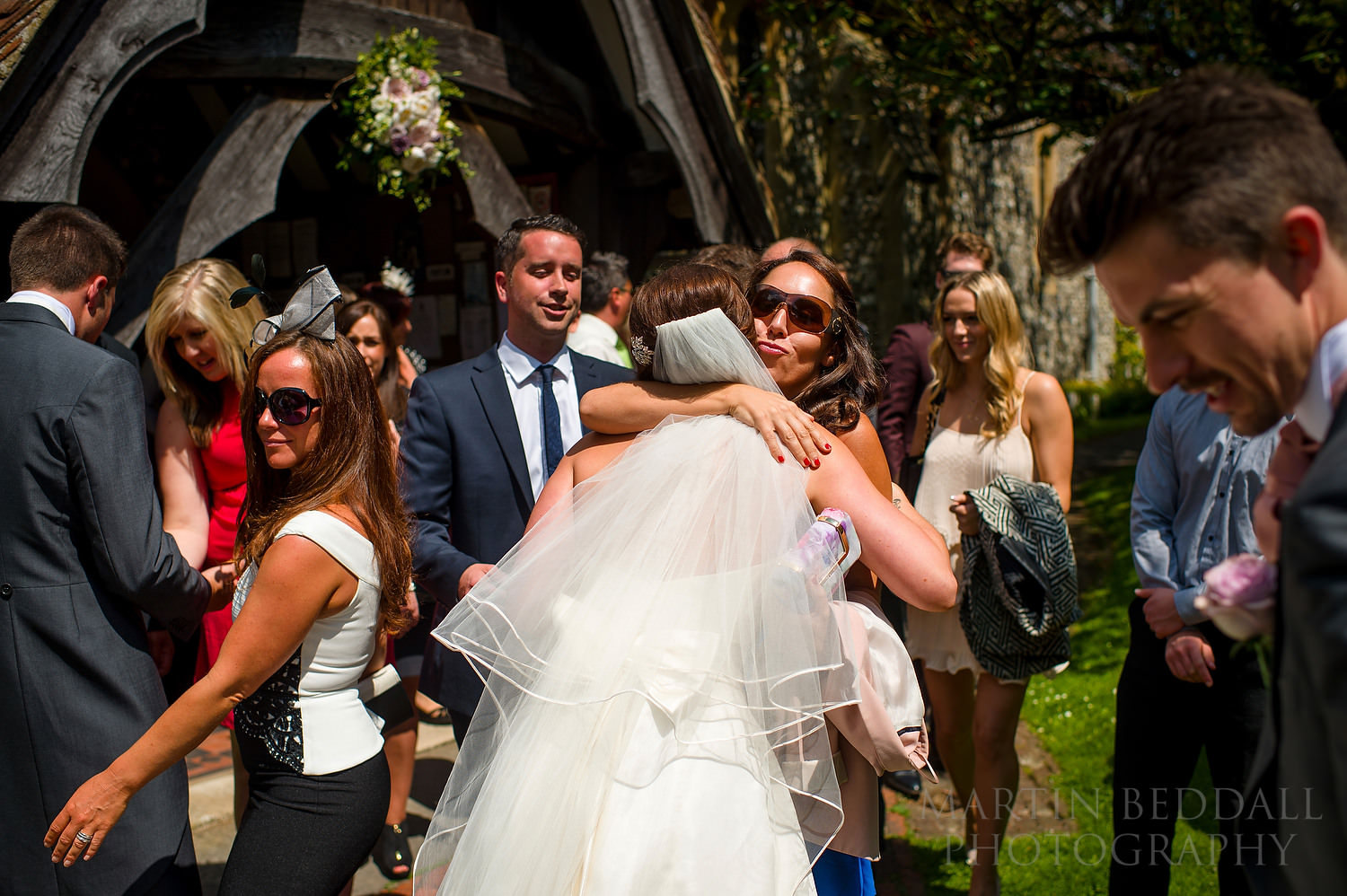 Hug for the bride outside the church