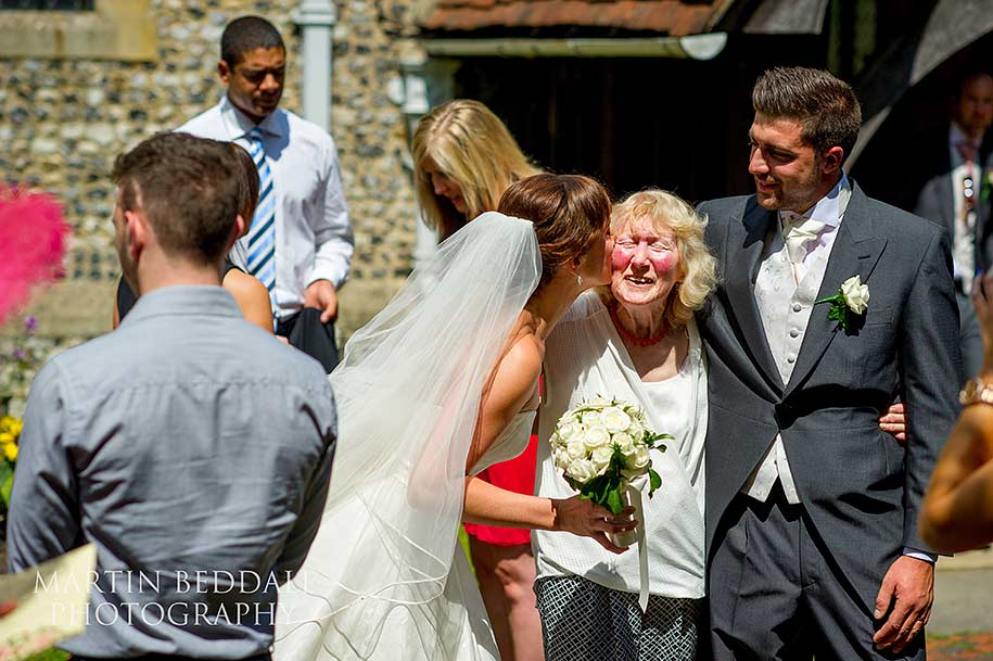 A kiss for the grom's granny from the bride