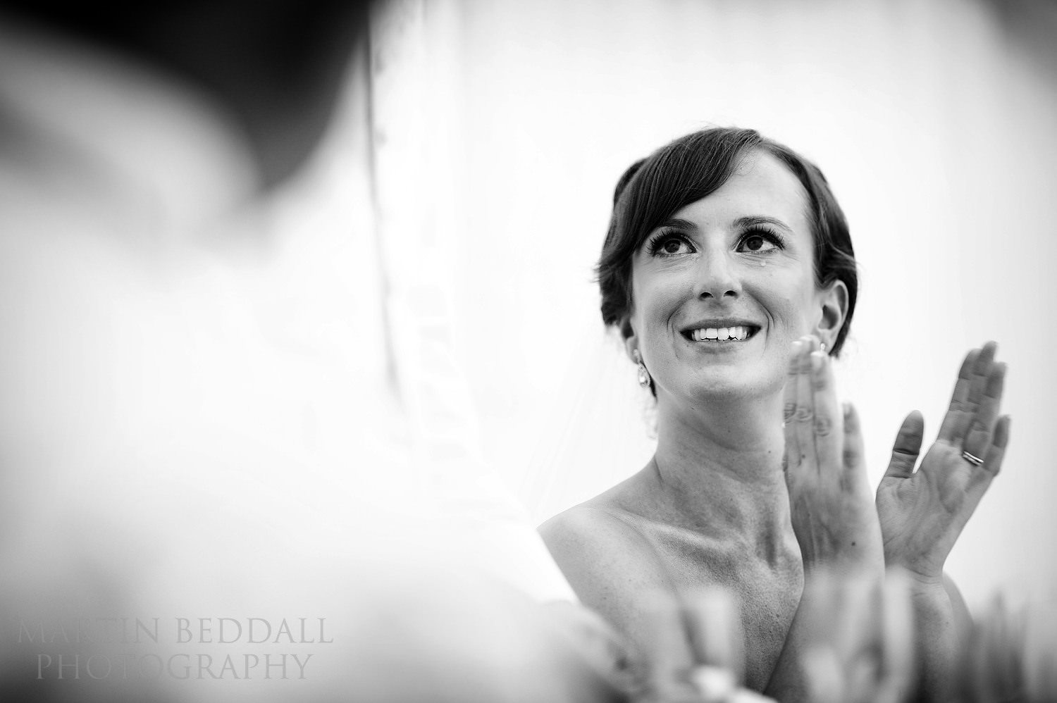 Tearful bride listening to the groom