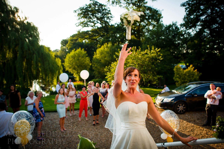Bride throwing the wedding bouquet