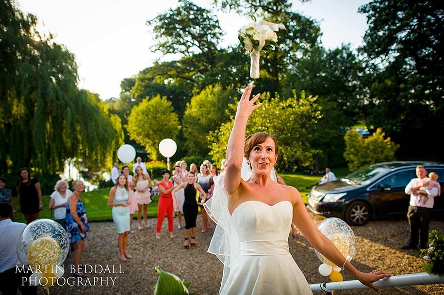 Bride tosses her wedding bouquet