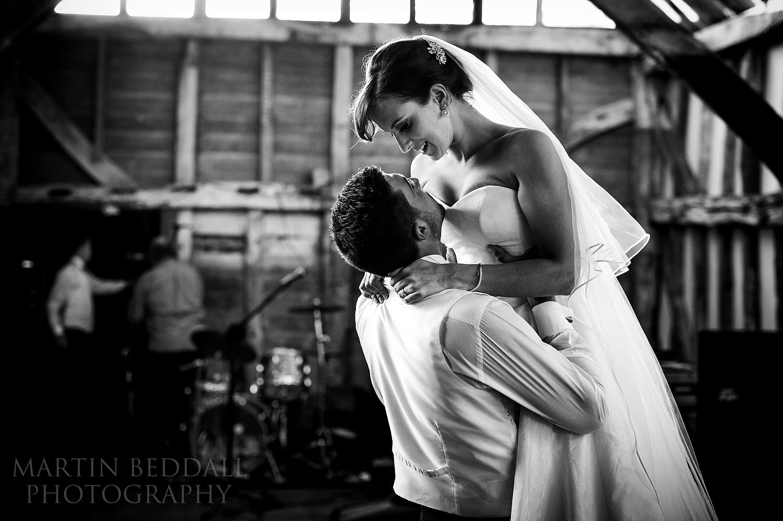 Bride and groom rehearse their wedding dance at Surrey garden wedding
