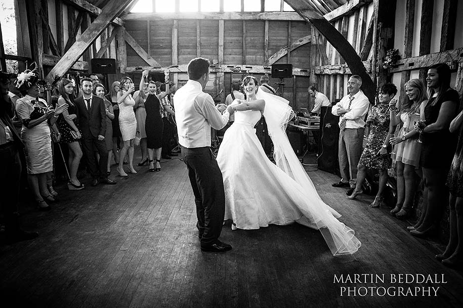 Groom spins the bride around during the first dance