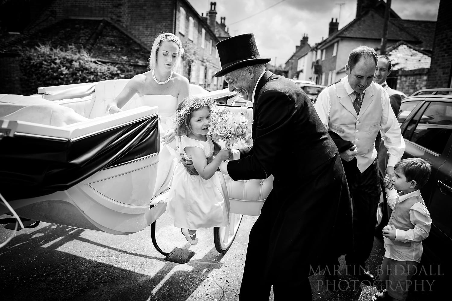 Flower girl lifted out of the carriage